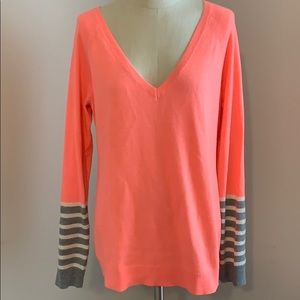 Neon orange sweater with striped sequin sleeves